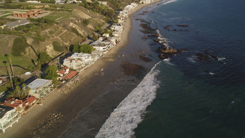 Passing a Row of Oceanfront Homes in Malibu, California Aerial Stock Footage | DCLA_168