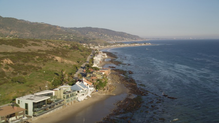 5K stock footage aerial video flyby a row of homes on the beach in Malibu, California Aerial Stock Footage | DCLA_169