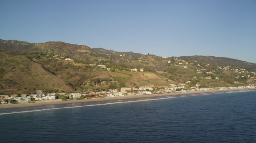 5K stock footage aerial video pan across homes on the coast of Malibu, California Aerial Stock Footage | DCLA_174