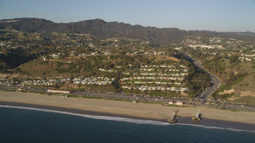 Passing Neighborhoods near the Beach and Highway 1 in Pacific Palisades Aerial Stock Footage | DCLA_178