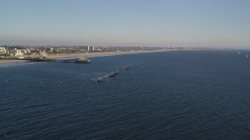 Passing Close to Santa Monica Pier and the Beach in California Aerial Stock Footage | DCLA_180