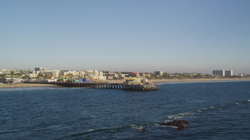 Fly Near the End of Santa Monica Pier with Rides in California Aerial Stock Footage | DCLA_181