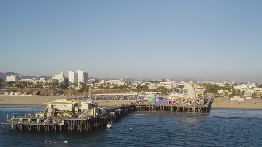 5K stock footage aerial video fly near the end of Santa Monica Pier with rides in California Aerial Stock Footage | DCLA_181