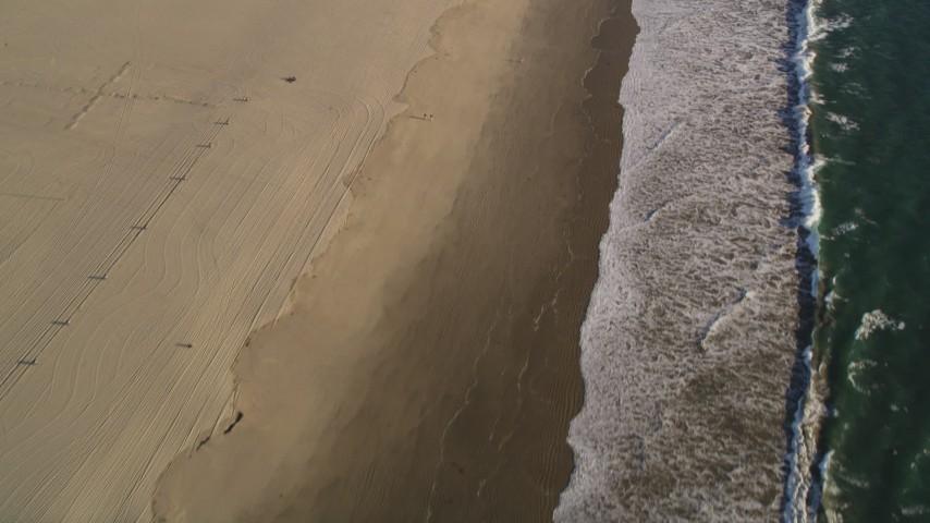 Tilt from beach and Follow the Coast of Venice, California Aerial Stock Footage | DCLA_183