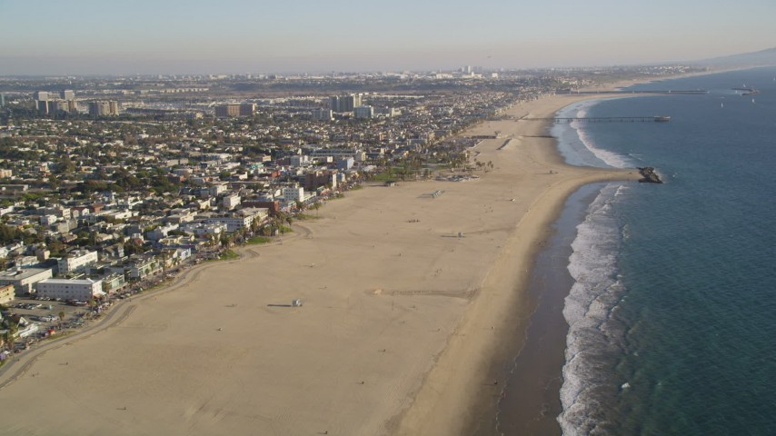 5K stock footage aerial video tilt from beach and follow the coast of Venice, California Aerial Stock Footage | DCLA_183