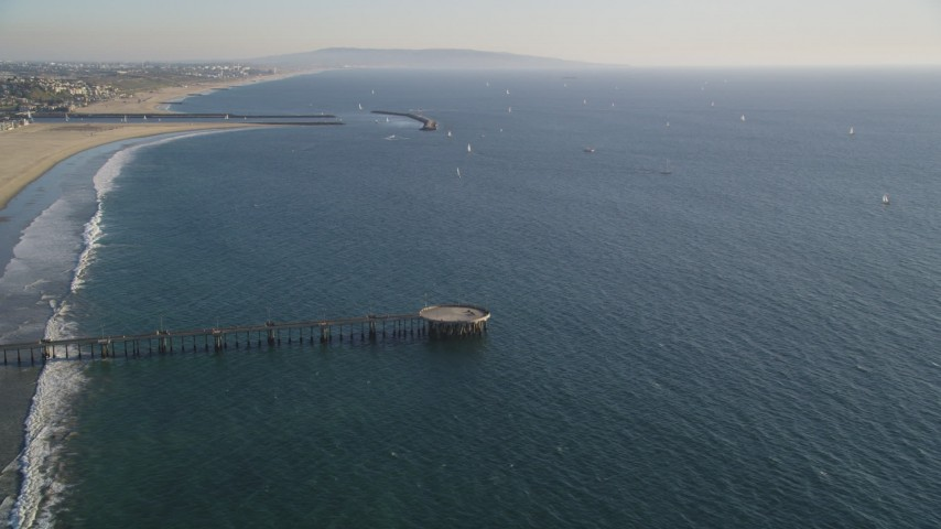 Sailboats Seen from Venice Fishing Pier in California Aerial Stock Footage | DCLA_185