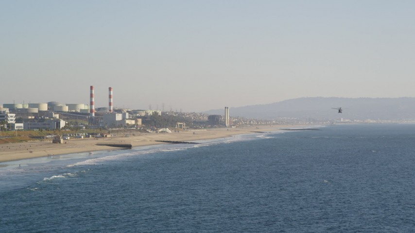 Follow Helicopter toward Beach and Oil Refinery in El Segundo, California Aerial Stock Footage | DCLA_189