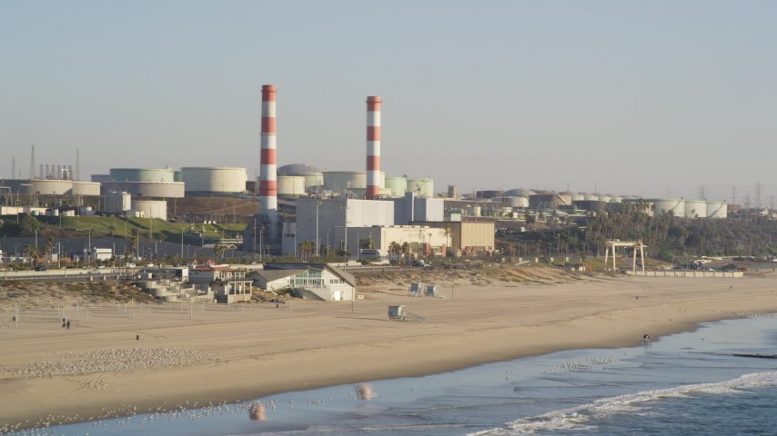 5K stock footage aerial video of beachside oil refinery with smoke stacks in El Segundo, California Aerial Stock Footage | DCLA_190