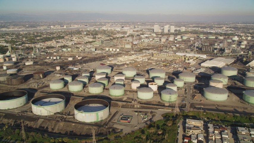5K stock footage aerial video of giant tanks at an oil refinery in El Segundo, California Aerial Stock Footage | DCLA_193