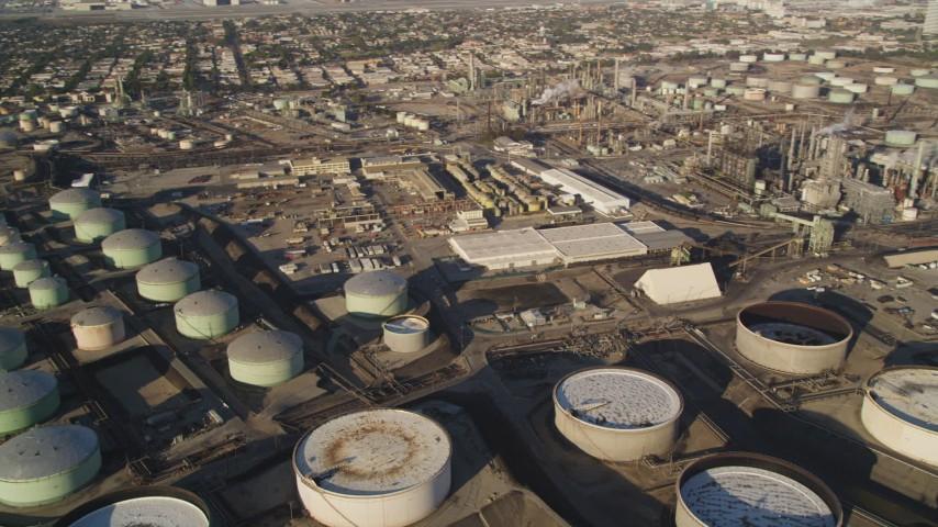 5K stock footage aerial video pan across oil refinery tanks and buildings in El Segundo, California Aerial Stock Footage | DCLA_194