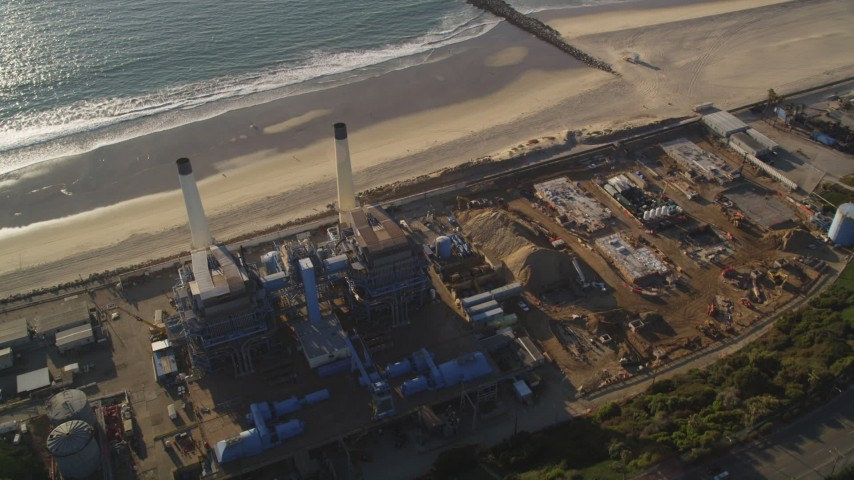 5K stock footage aerial video fly over tanks to approach smoke stacks and beach in El Segundo, California Aerial Stock Footage | DCLA_196