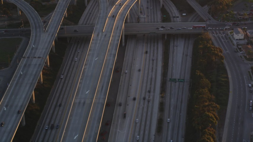 5K stock footage video of freeway interchange between I-110 and 105 in Westmont at sunset, California Aerial Stock Footage | DCLA_205