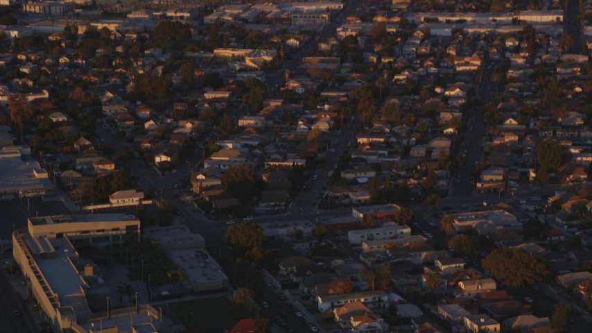 5K stock footage aerial video tilt from Downtown Los Angeles to urban residential neighborhoods at sunset, California Aerial Stock Footage | DCLA_207