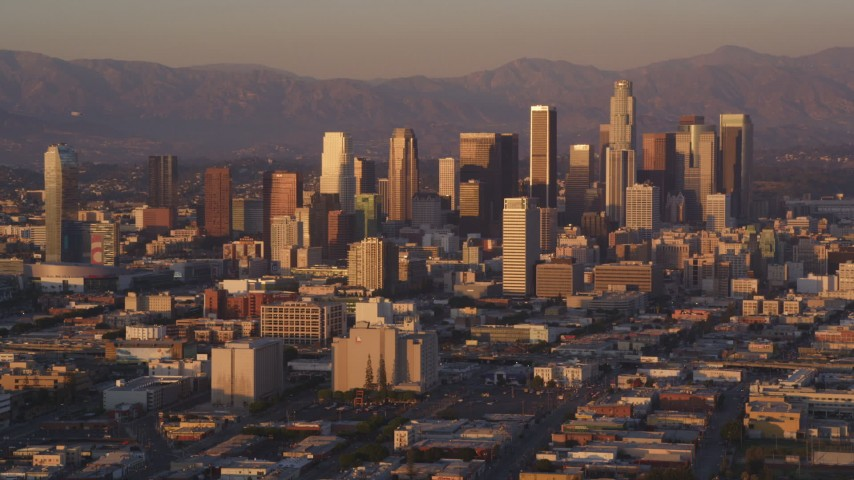 5K stock footage aerial video of a slow approach to Downtown Los Angeles, California at sunset Aerial Stock Footage | DCLA_208