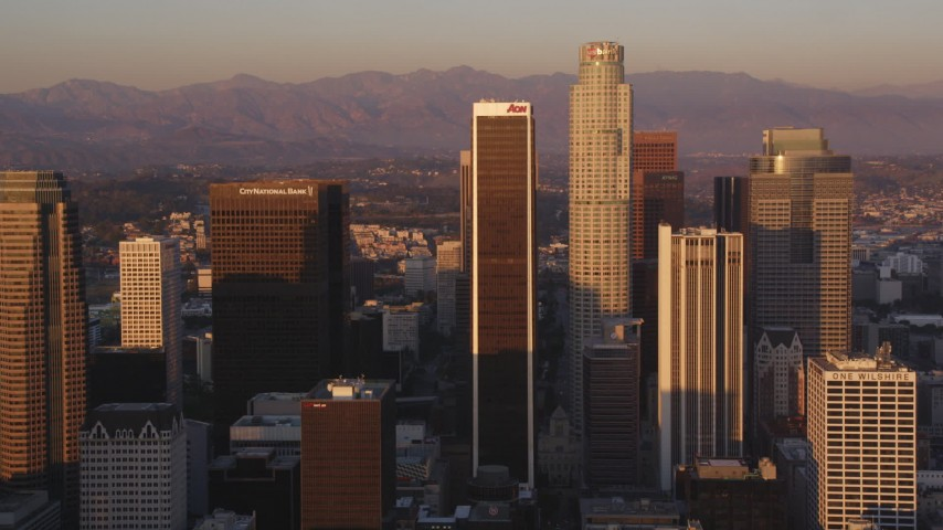 5K stock footage aerial video tilt up Hope Street to reveal skyscrapers in Downtown Los Angeles at sunset, California Aerial Stock Footage | DCLA_212