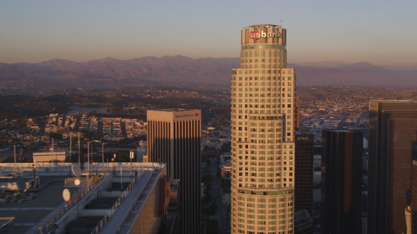 5K stock footage aerial video tilt from Hope Street to approach Aon Center and US Bank Tower at sunset in Downtown Los Angeles, California Aerial Stock Footage | DCLA_213