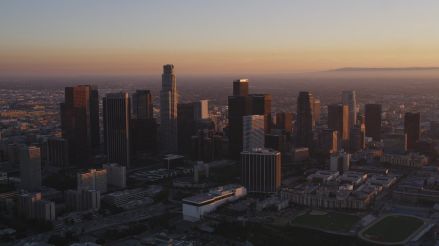 5K stock footage aerial video of skyscrapers in Downtown Los Angeles at sunset, California Aerial Stock Footage | DCLA_216