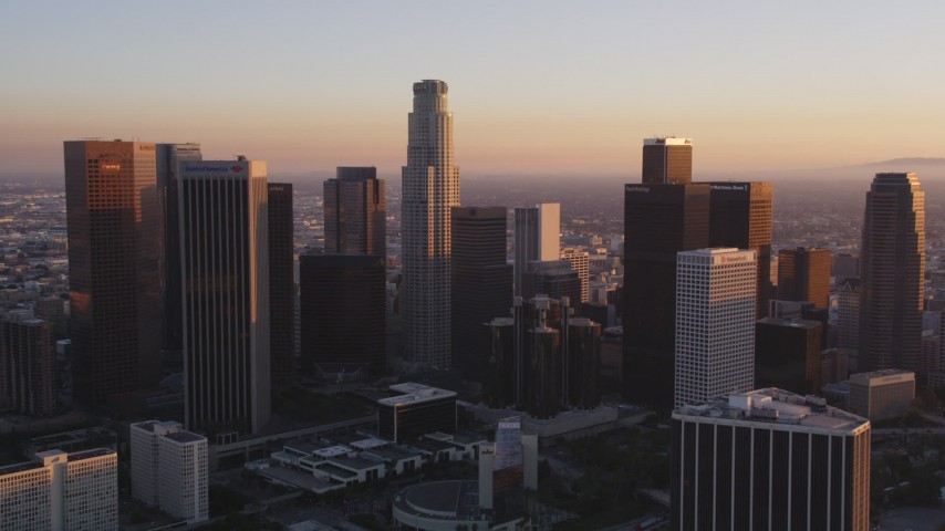 Tilt to Reveal and Approach Downtown Los Angeles and Bonaventure Hotel at Sunset Aerial Stock Footage | DCLA_217
