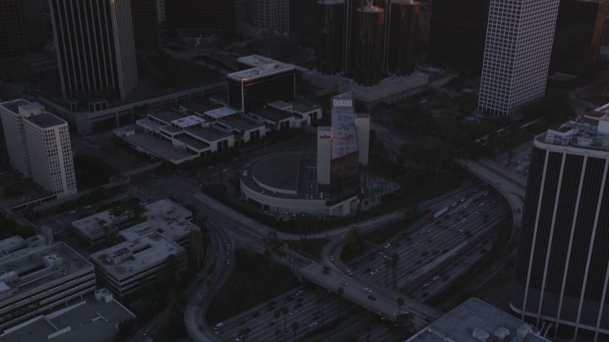 5K stock footage aerial video approach Downtown Los Angeles and tilt to reveal Highway 110 at sunset, California Aerial Stock Footage | DCLA_218