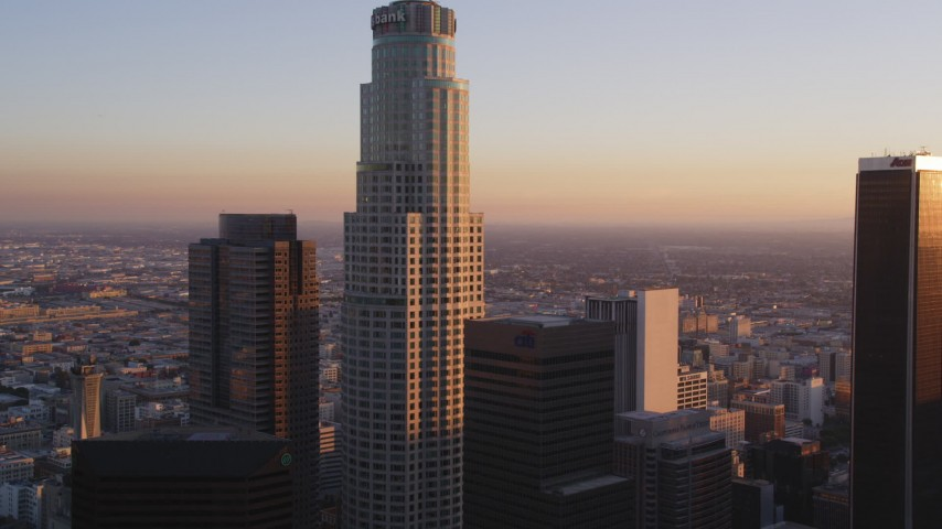 5K stock footage aerial video tilt from 110 freeway to reveal and approach US Bank Tower in Downtown Los Angeles at sunset, California Aerial Stock Footage | DCLA_219