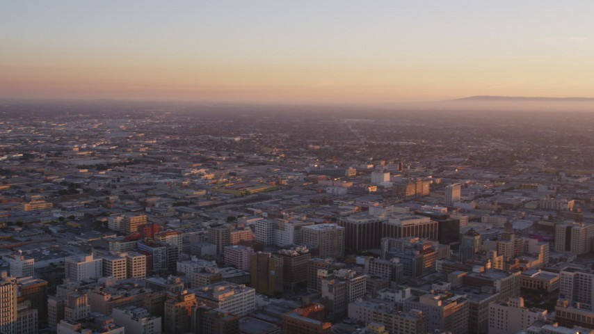 Approach Center of US Bank Tower and Reveal South Side of Downtown Los Angeles at Sunset Aerial Stock Footage | DCLA_220