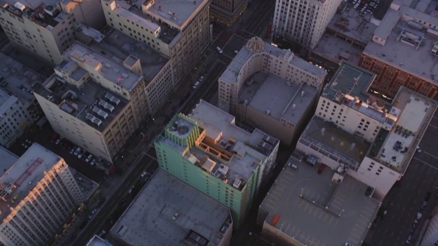 Bird's Eye View of City Streets and Buildings in Downtown Los Angeles at Sunset Aerial Stock Footage | DCLA_221