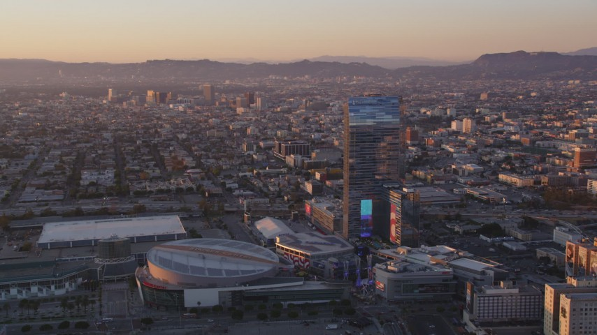 5K stock footage aerial video of Staples Center and Ritz-Carlton Hotel in Downtown Los Angeles at sunset, California Aerial Stock Footage | DCLA_224