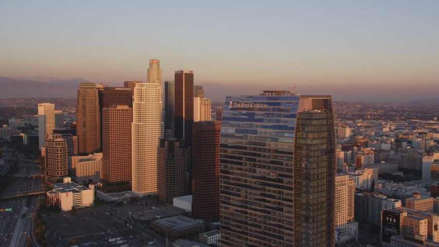 5K stock footage aerial video flyby Downtown Los Angeles at sunset to reveal The Ritz-Carlton, California Aerial Stock Footage | DCLA_226
