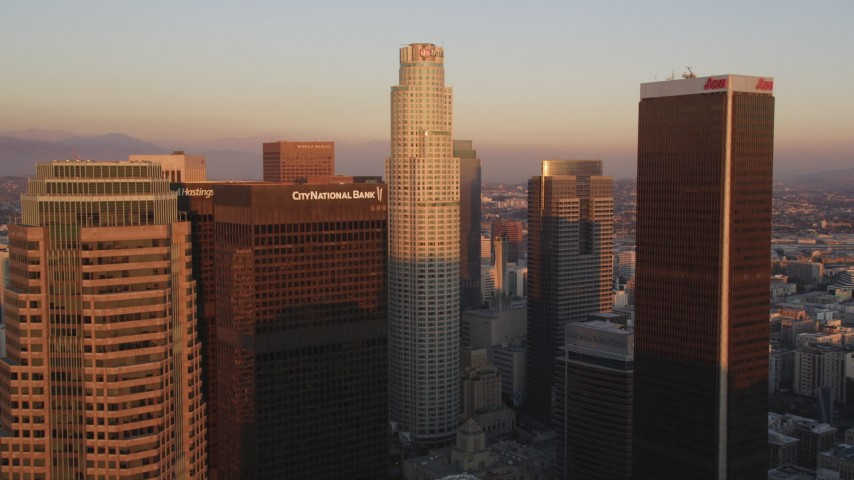 5K stock footage aerial video tilt to reveal and approach US Bank Tower and skyscrapers at sunset in Downtown Los Angeles, California Aerial Stock Footage | DCLA_228