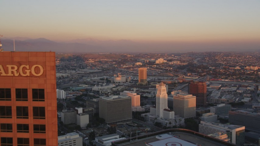 5K stock footage aerial video fly over Downtown Los Angeles towers to reveal city hall at sunset, California Aerial Stock Footage | DCLA_229