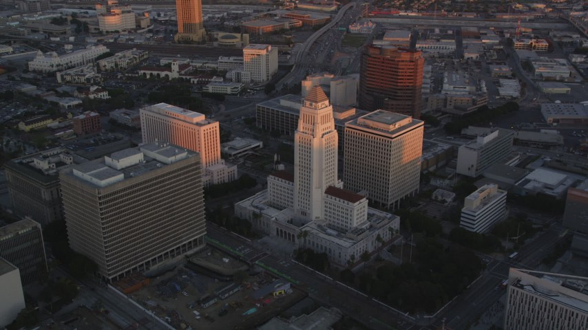 5K stock footage aerial video approach Los Angeles City Hall in Downtown Los Angeles at sunset, California Aerial Stock Footage | DCLA_230