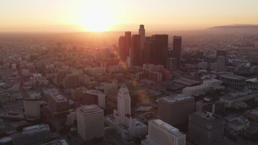 Fly Away from City Hall at Sunset to Reveal Downtown Los Angeles Skyline Aerial Stock Footage | DCLA_231