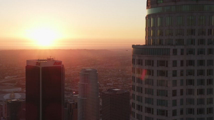 Flyby US Bank Tower in Downtown Los Angeles with Setting Sun in the Distance Aerial Stock Footage | DCLA_234