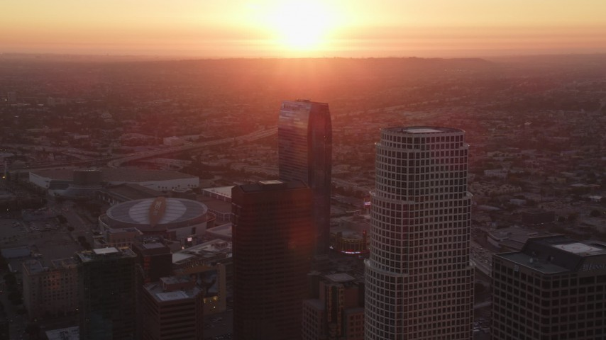 5K stock footage aerial video fly between towers to reveal Staples Center and The Ritz-Carlton at sunset in Downtown Los Angeles, California Aerial Stock Footage | DCLA_235
