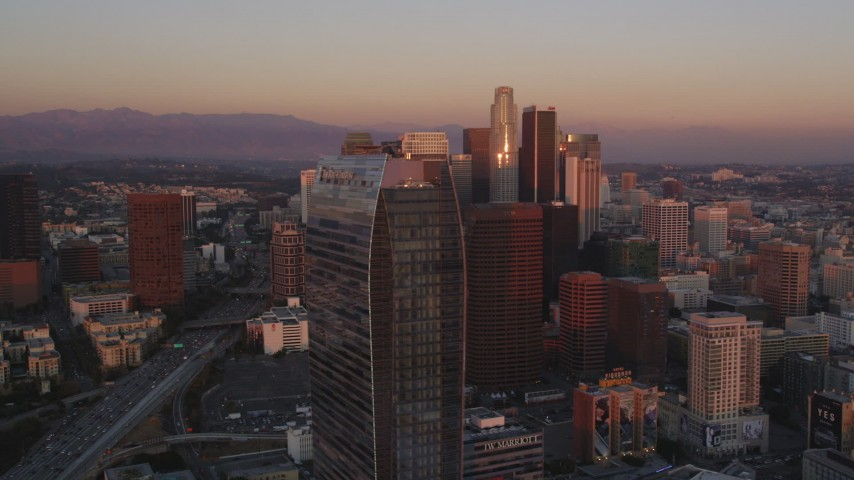 Flyby Ritz-Carlton and Downtown Los Angeles Skyscrapers at twilight Aerial Stock Footage | DCLA_237