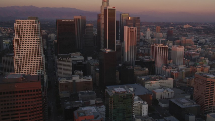 5K stock footage aerial video tilt from dark streets to reveal Downtown Los Angeles high-rises at twilight, California Aerial Stock Footage | DCLA_238