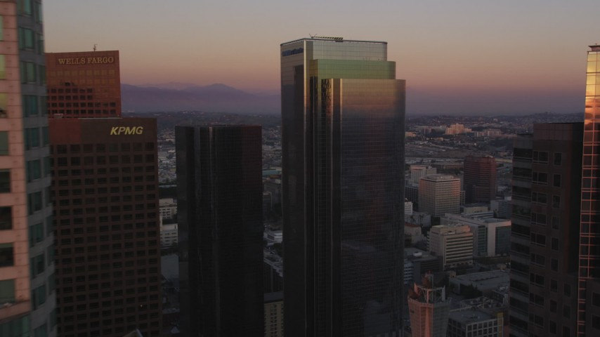 5K stock footage aerial video flyby middle floors of US Bank Tower at twilight in Downtown Los Angeles, California Aerial Stock Footage | DCLA_239