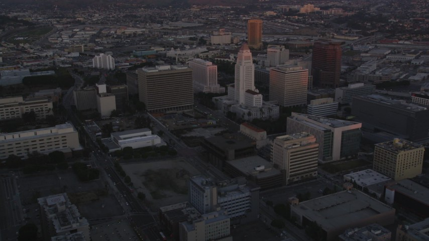 5K stock footage aerial video flyby Deloitte & Touche toward city hall in Downtown Los Angeles at twilight, California Aerial Stock Footage | DCLA_240