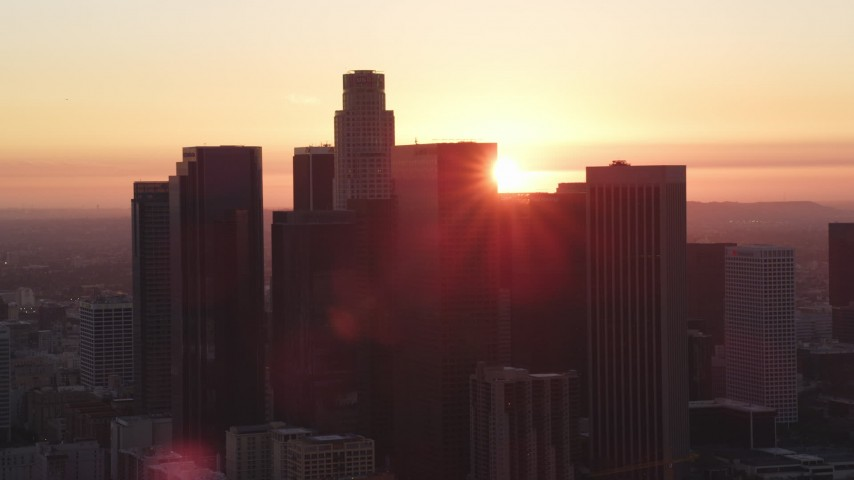 5K stock footage aerial video of Downtown Los Angeles skyline silhouetted by the setting sun, California Aerial Stock Footage | DCLA_243