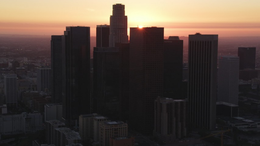 5K stock footage aerial video of Downtown Los Angeles skyline with sunset in background, California Aerial Stock Footage | DCLA_244