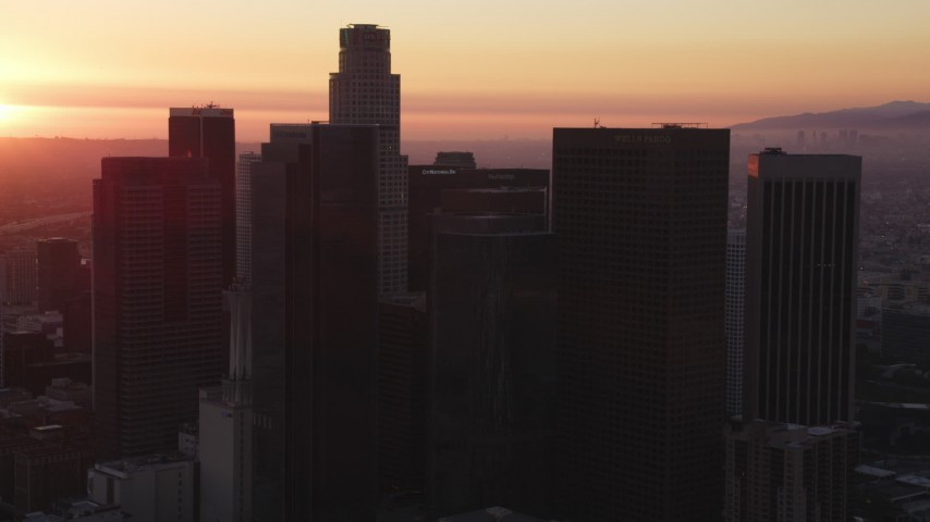 5K stock footage aerial video of Downtown Los Angeles skyline with sunset on the horizon, California Aerial Stock Footage | DCLA_245