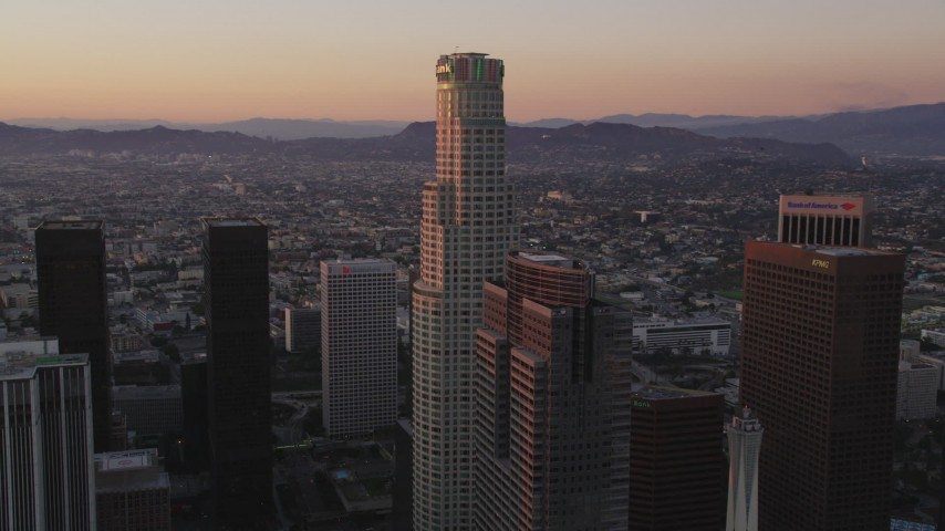 5K stock footage aerial video of US Bank Tower with skyscrapers in Downtown Los Angeles at sunset, California Aerial Stock Footage | DCLA_246