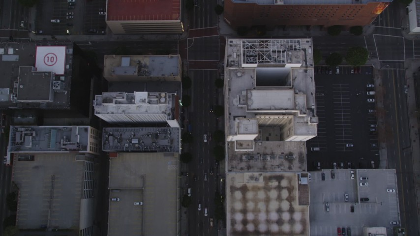 5K stock footage aerial video bird's eye view of Flower Street through Downtown Los Angeles at twilight, California Aerial Stock Footage | DCLA_248