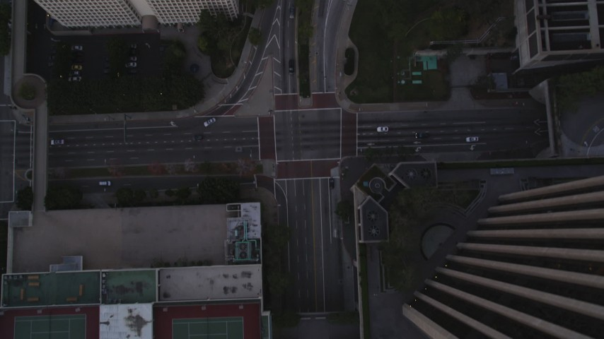 Bird's Eye of Flower Street in Downtown Los Angeles at twilight Aerial Stock Footage | DCLA_250