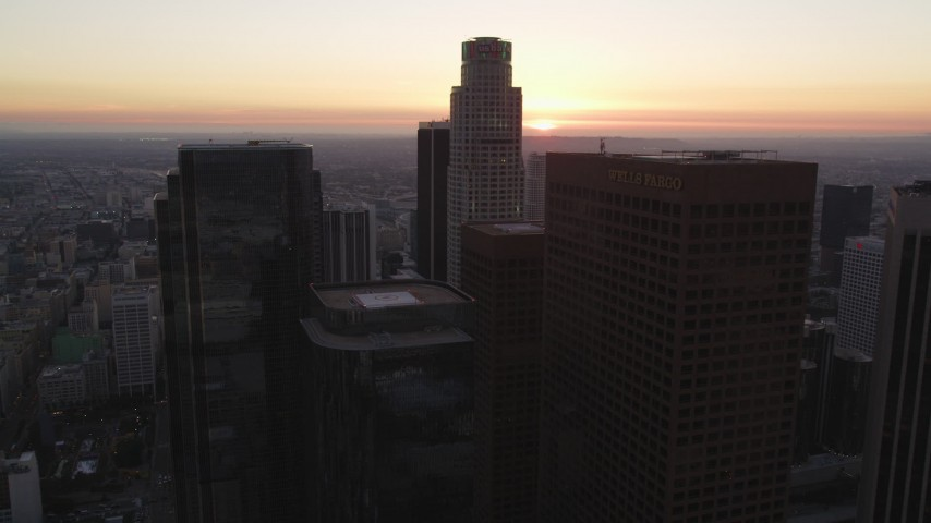 5K stock footage aerial video tilt from streets to reveal and approach skyscrapers at twilight in Downtown Los Angeles, California Aerial Stock Footage | DCLA_251