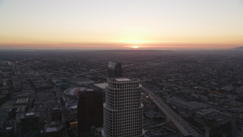 Fly Over Downtown Los Angeles toward Setting Sun Aerial Stock Footage | DCLA_253