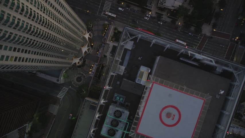 Bird's Eye View of City Streets and High-Rises in Downtown Los Angeles at twilight Aerial Stock Footage | DCLA_260