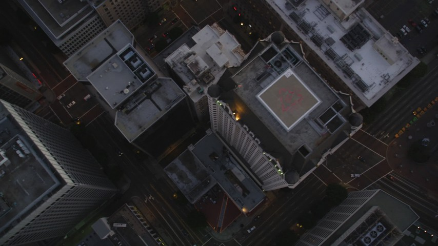 5K stock footage aerial video of a bird's eye view of streets through Downtown Los Angeles at twilight, California Aerial Stock Footage | DCLA_261