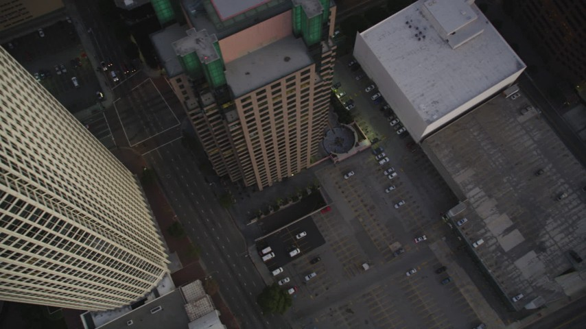 Bird's Eye of City Streets and Parking Lot at twilight in Downtown Los Angeles Aerial Stock Footage | DCLA_262