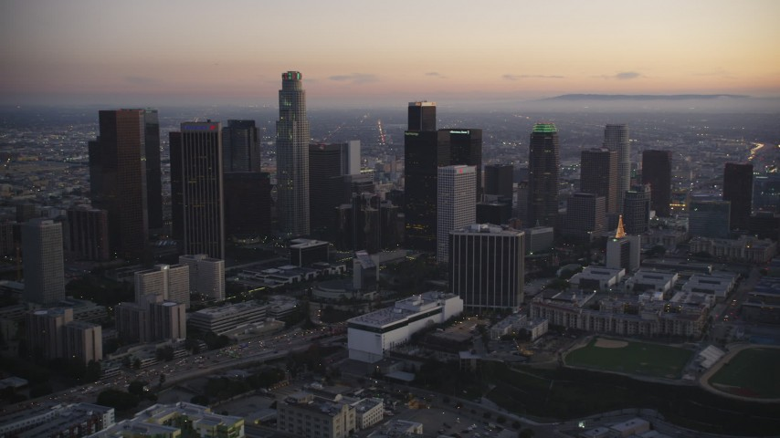 5K stock footage aerial video of Downtown Los Angeles skyline at twilight in wintertime, California Aerial Stock Footage | DCLA_266